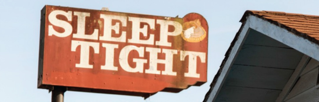 Building sign stating to 'Sleep Tight'